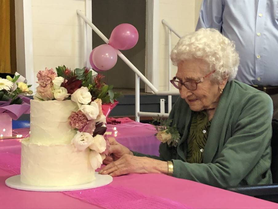 CAKE: Mrs Lockery celebrated surrounded by family and friend of 70 years Joan Ticehurst at Grace Munro Centre.