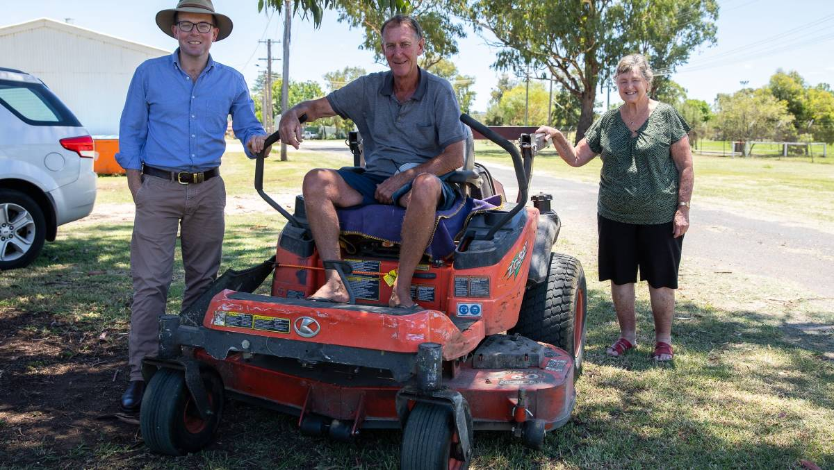Inverell Showground Trust will soon purchase a brand new zero-turn lawn mower to keep the grounds looking tidy, Northern Tablelands MP Adam Marshall, left, Showground caretaker Chris Bell and Showground Trust member Heather Morris with the soon-to-be-replaced mower.